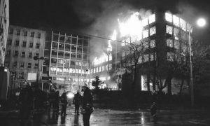 The RTS building in Belgrade, Serbia, burns after it was hit with a NATO missile on April 23, 1999, killing 16 inside. Photo via SerbiaSos.