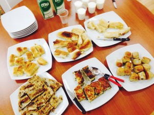 Various varieties of burek are served with yogurt in Pristina, Kosovo.