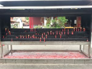 When we got there we were given two candles and some incense. Once we got to the kiosks where they go, I lit my candles with the flame of another, then placed them down inside the kiosk.