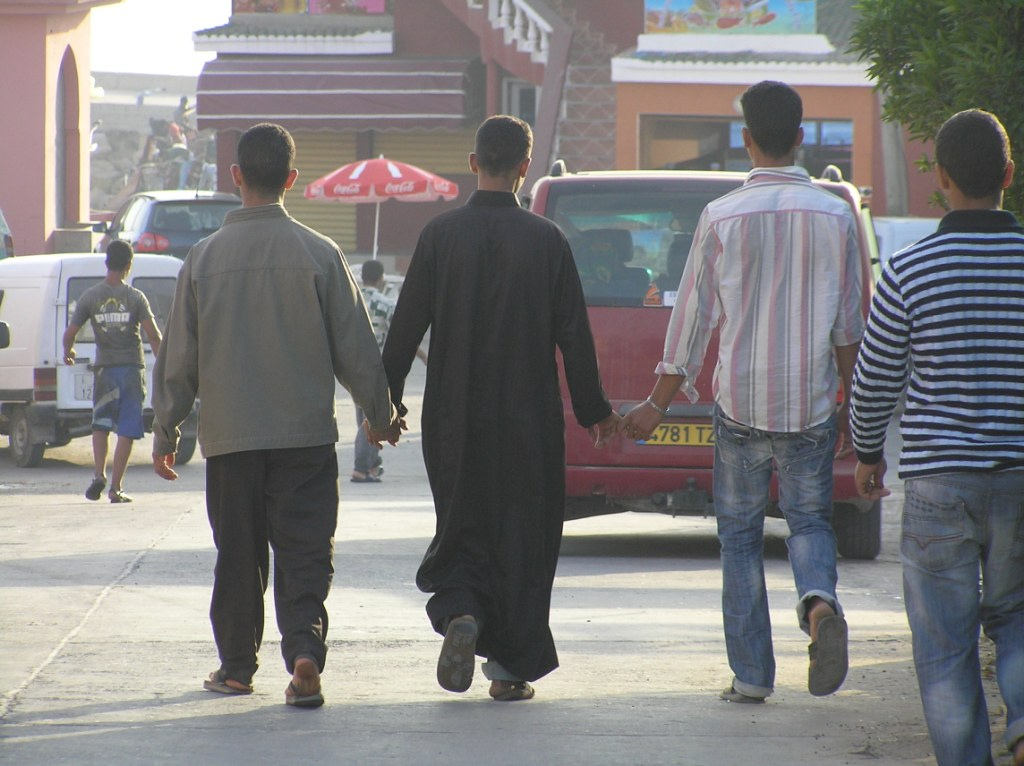 https://gilmanprogram.files.wordpress.com/2015/10/men-holding-hands-in-middle-east.jpg