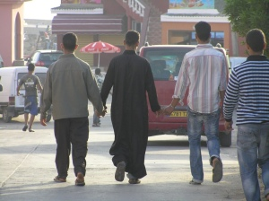 Men holding hands in Middle East