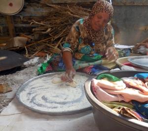 Madia making bread.