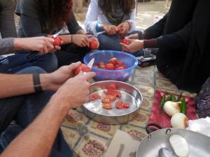 Peeling tomatoes.