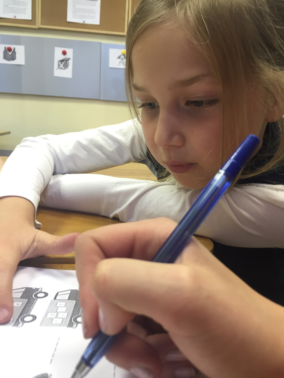 """One of my star students, Dasha, as she tries to read, """"school, bus, train..."""""""