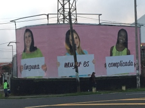 "The giant billboard in front of my neighborhood which translates as ""Nothing about Women is complicated."" This is an advertisement for Banca Kristal. Does this ad challenge or perpetuate sexism?"