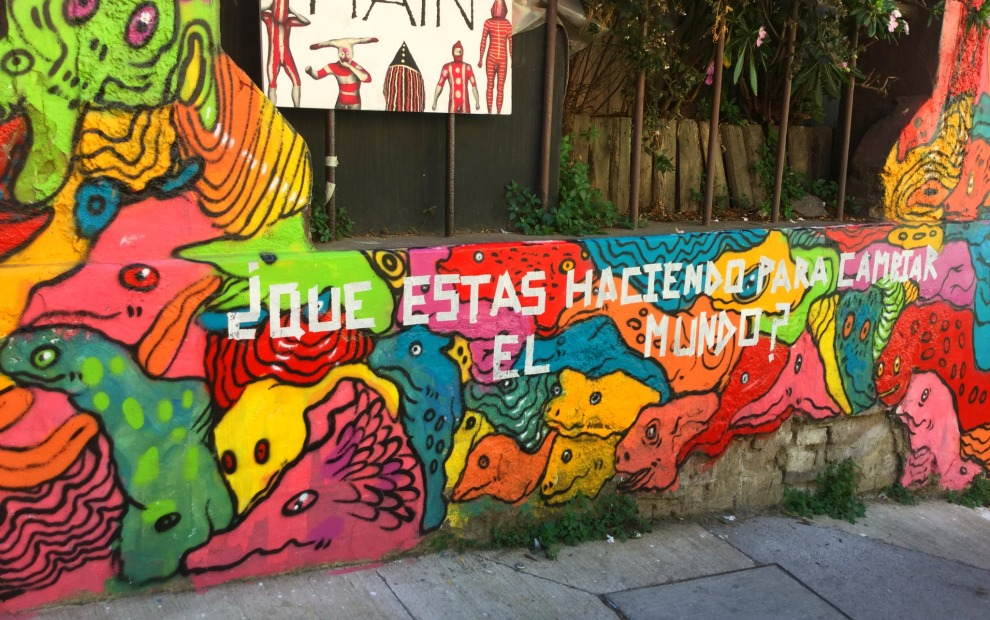 """""""What are you doing to change the world?"""" Colorful, thought-provoking murals are at the core of Valparaiso's spirit."""