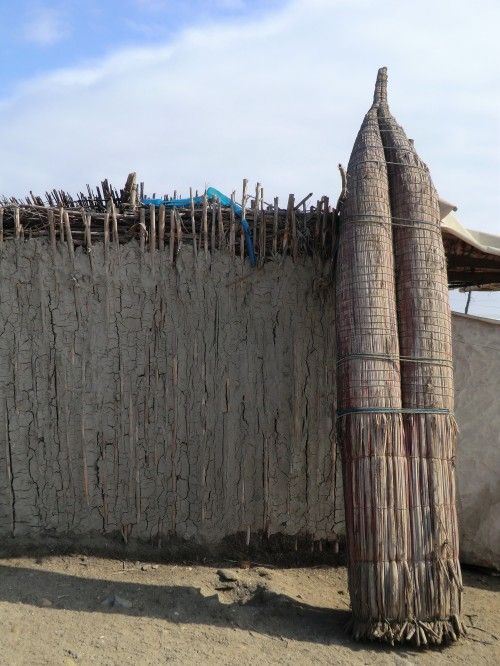 reed boat on traditional fisherman house